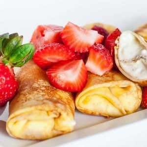 cheese filled crepes with strawberries