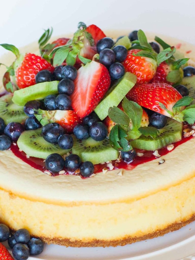 classic cheesecake with fruit, sauce and nuts