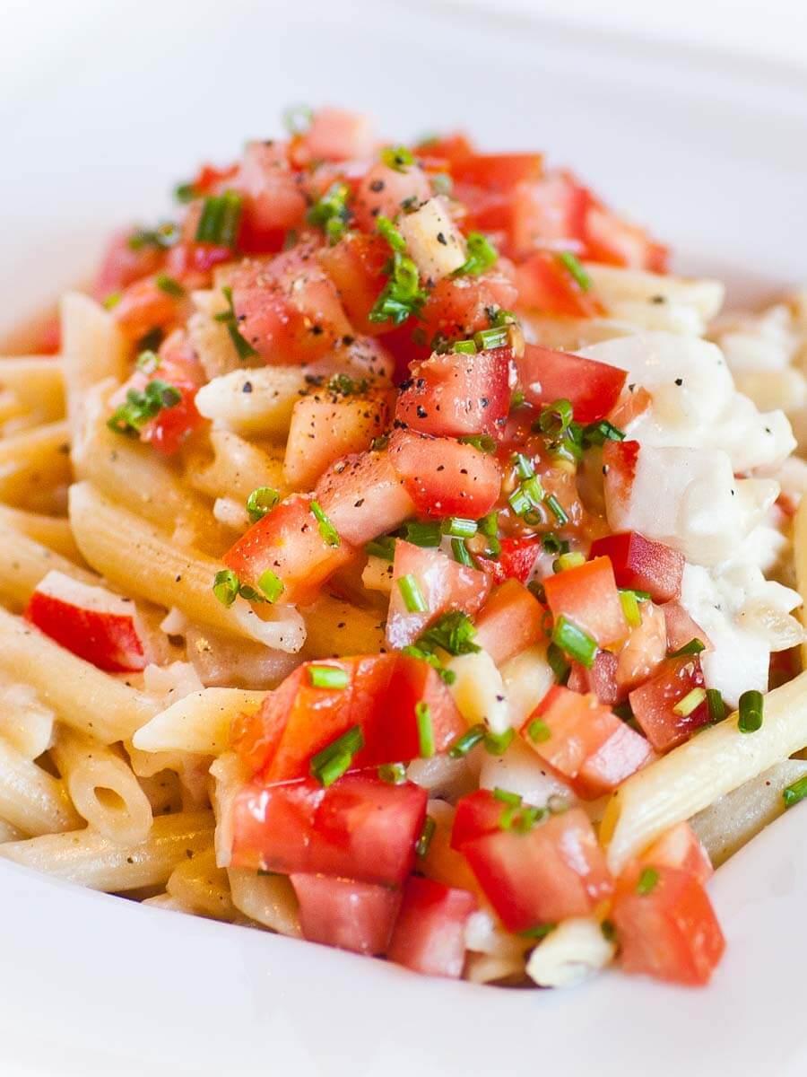 creamy crab alfredo pasta with tomato topping