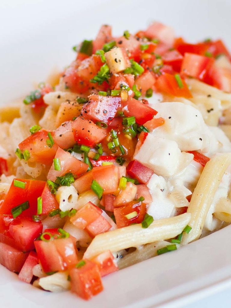 seafood pasta with real crab and tomatoes