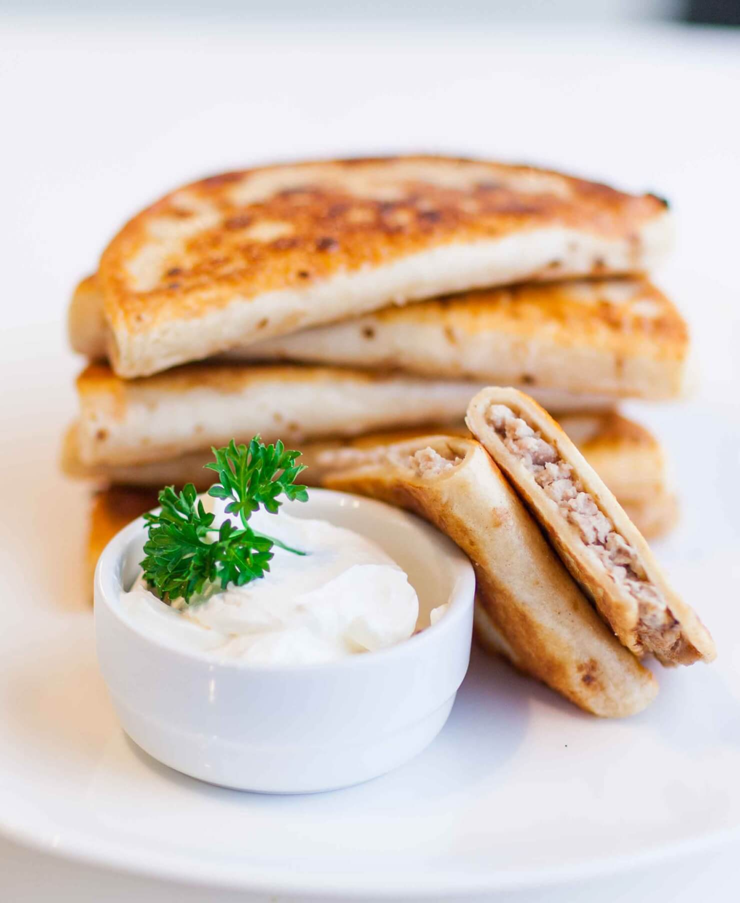 chebureki with sour cream