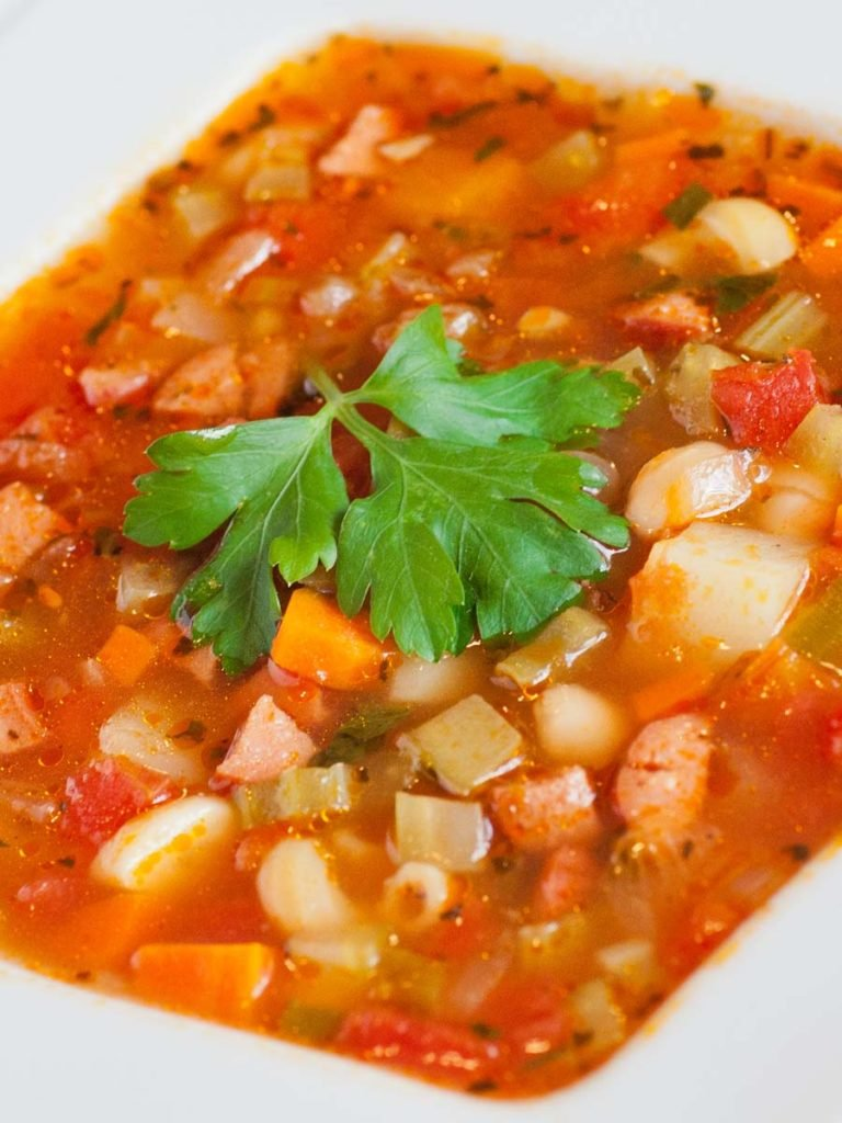 Italian soup recipe with tomatoes, sausage and beans