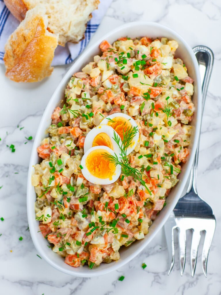 Olivier Russian potato salad with eggs, carrots and sausage