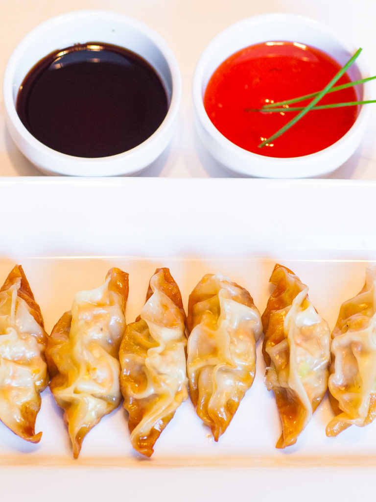 pork potstickers with soy sauce and sweet chili dipping sauce