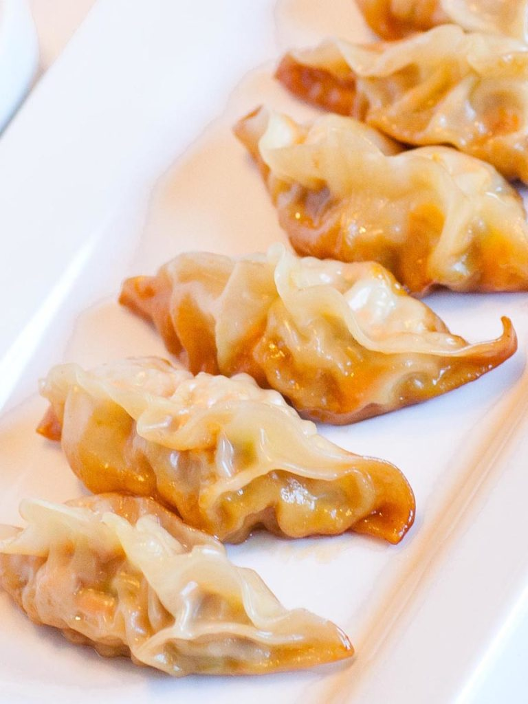 ginger garlic pork dumplings with cabbage, carrots and mushrooms