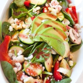 spinach salad with avocado, feta cheese and raspberry dressing