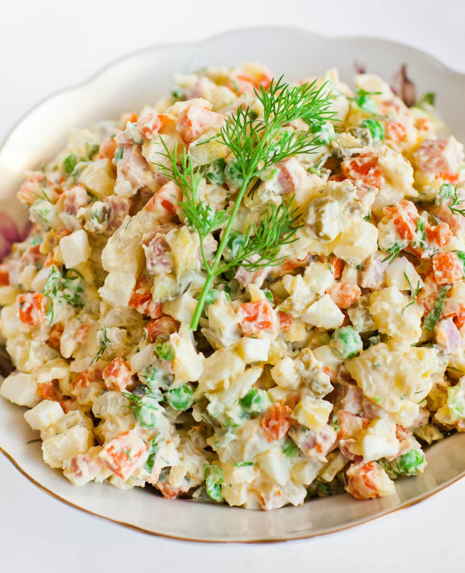 Russian potato salad in bowl