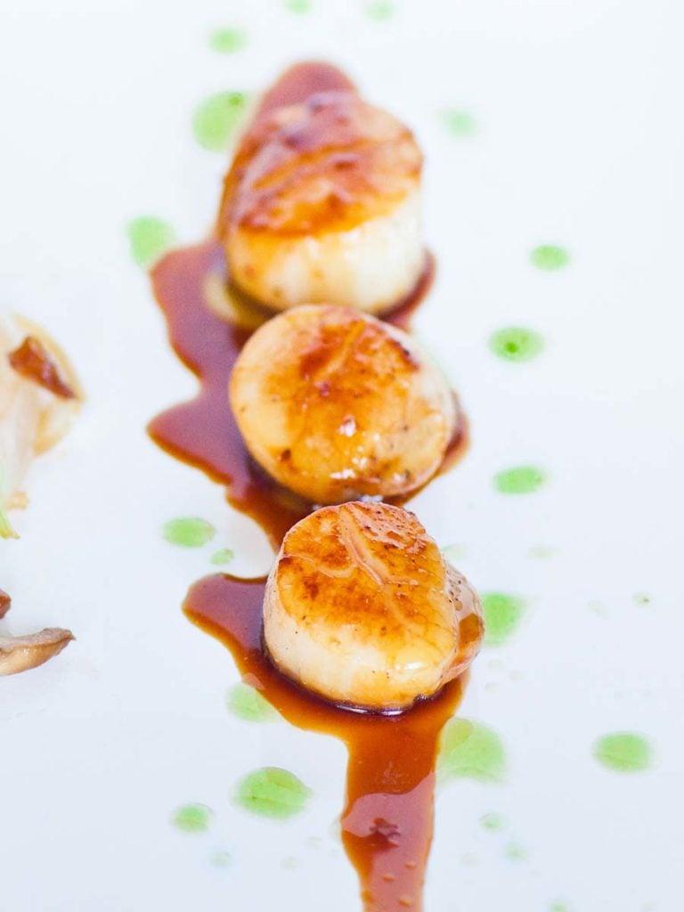 pan-seared scallops with basil oil and teriyaki sauce