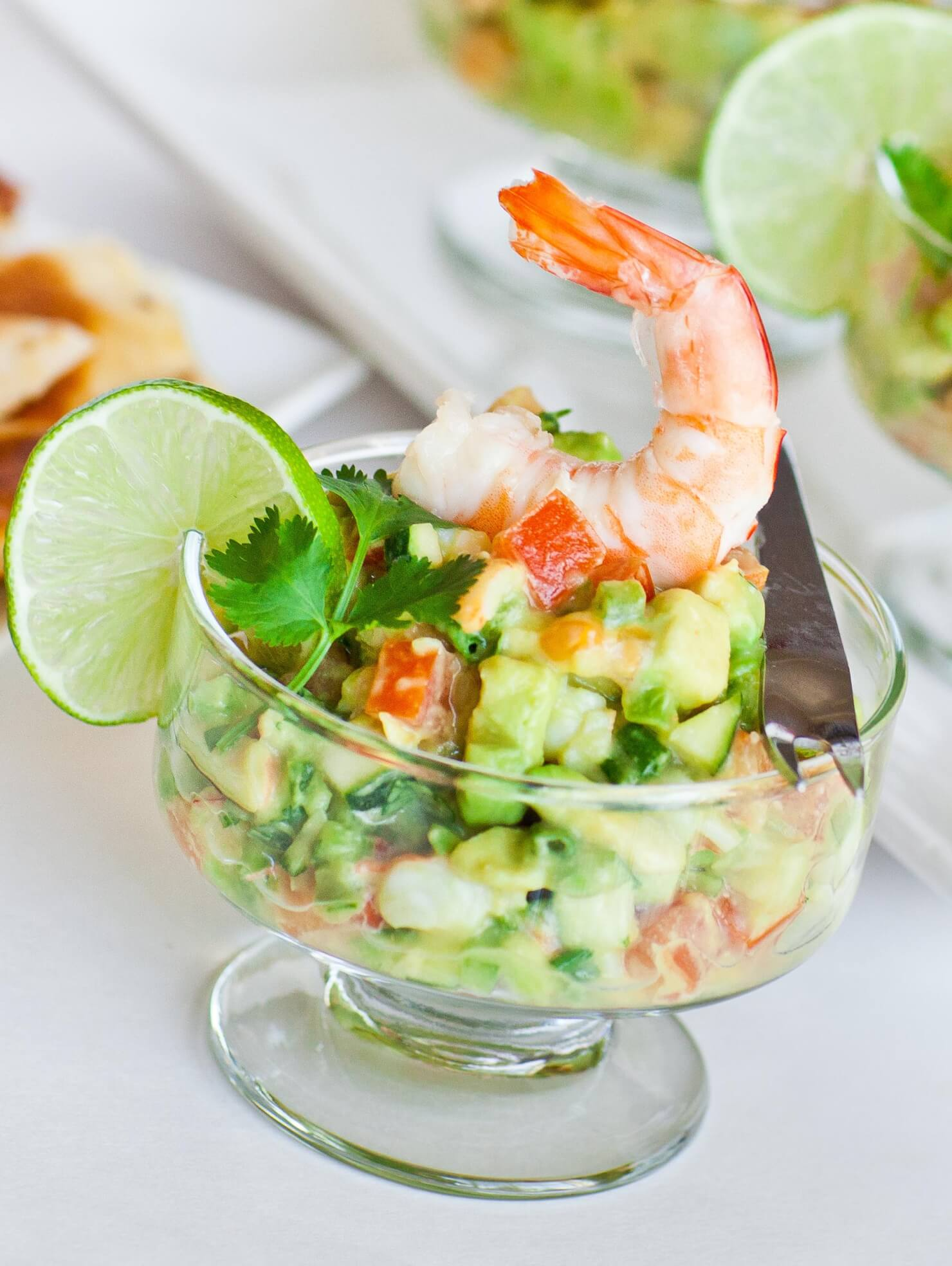 avocado shrimp ceviche in cup with lime