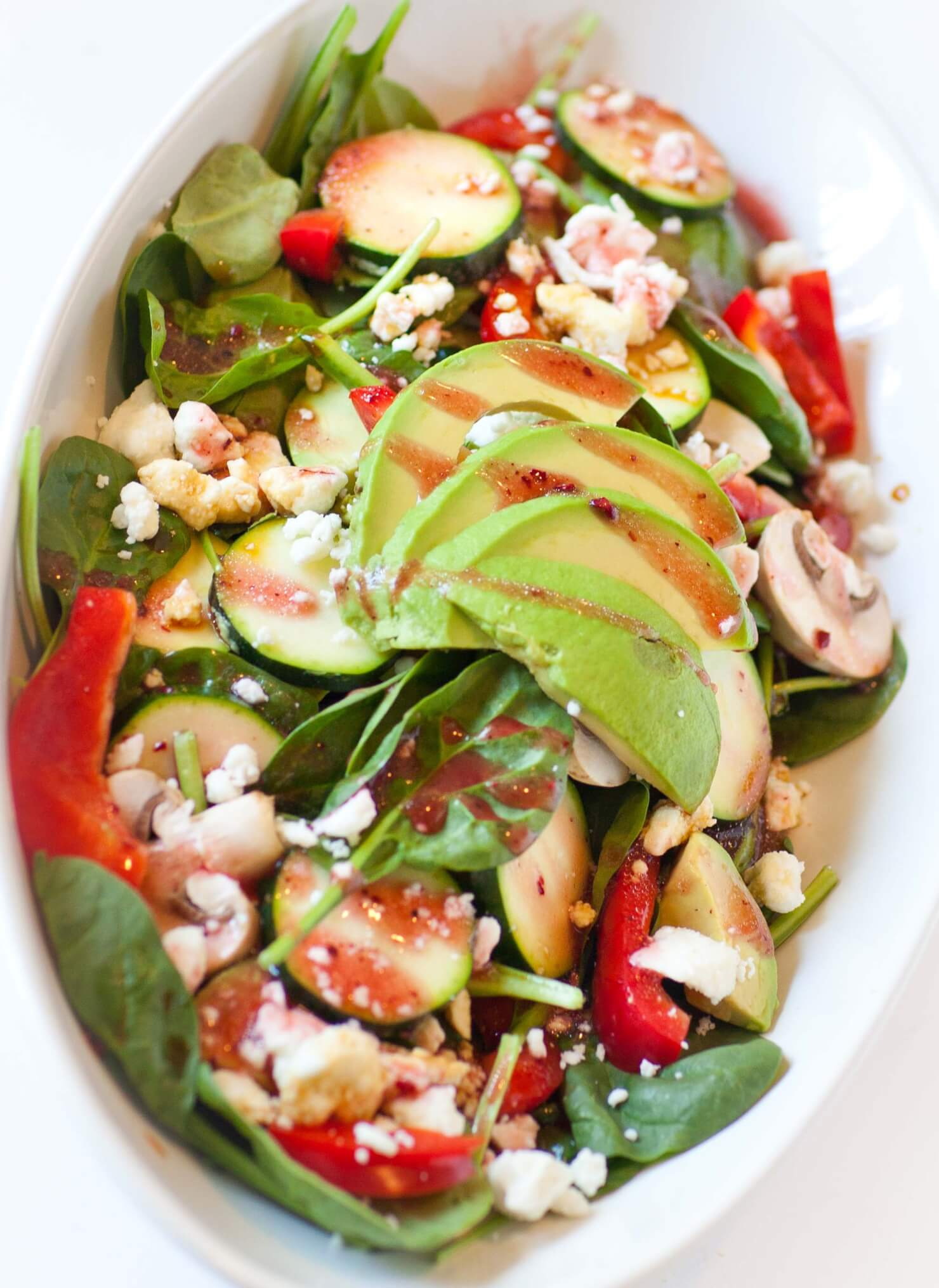 avocado spinach salad with feta and zucchini