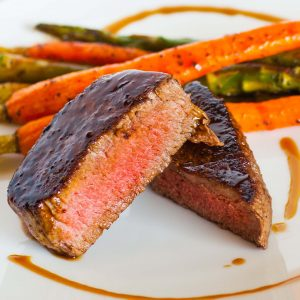 filet mignon steak with veggies and sauce