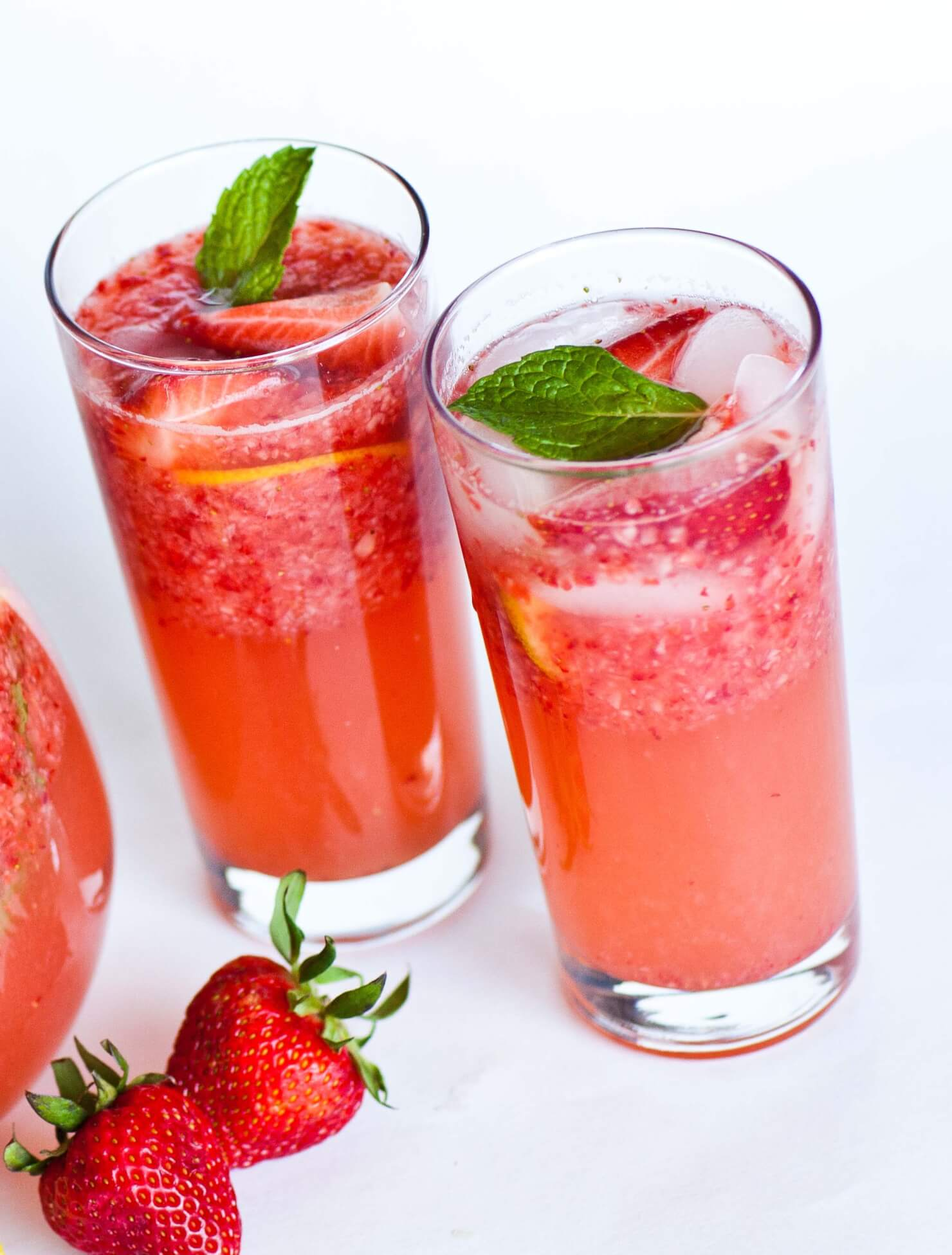 strawberry lemonade in glasses with mint leaves