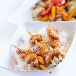 teriyaki chicken skewers over rice
