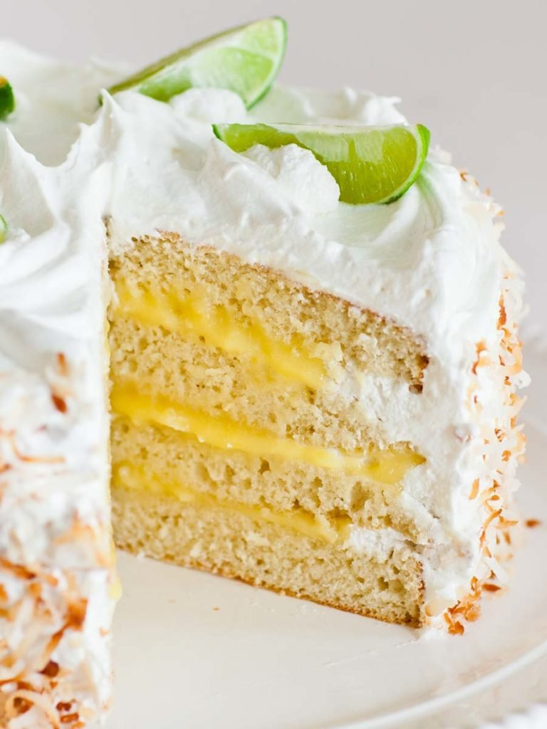 coconut cake with lime curd and meringue frosting
