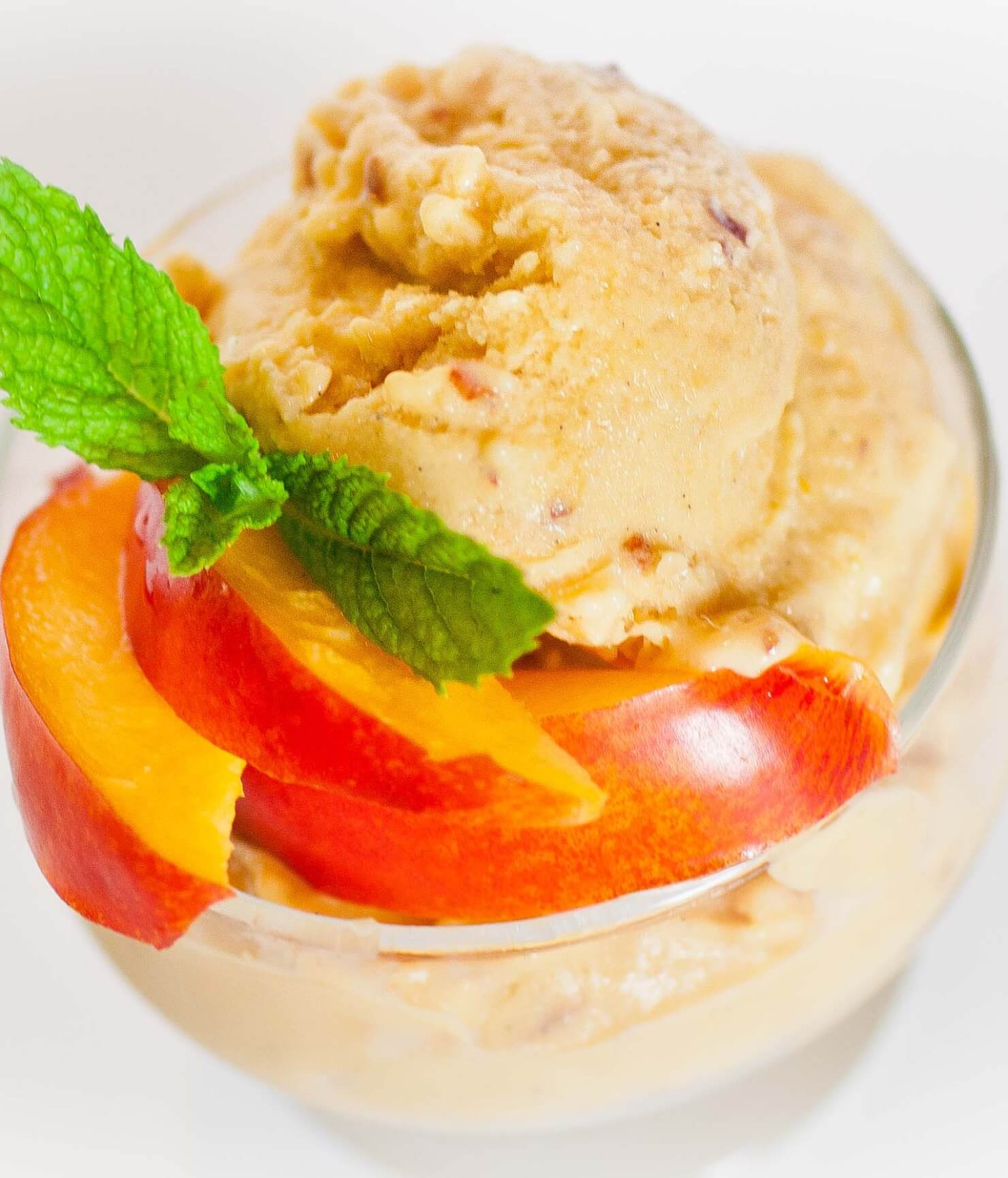mango peach sorbet with sliced peaches
