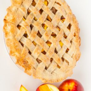 classic peach pie with cinnamon crumble and butter crust