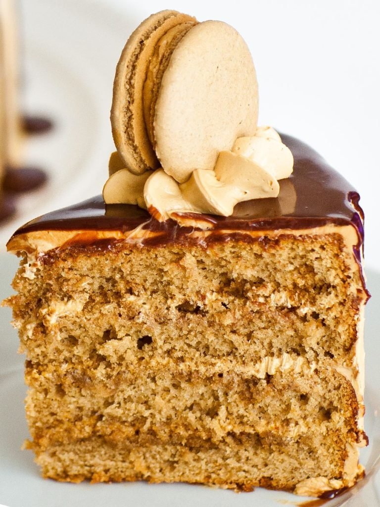slice of caramel coffee cake with coffee macaron