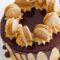 coffee caramel cake with chocolate ganache and macarons