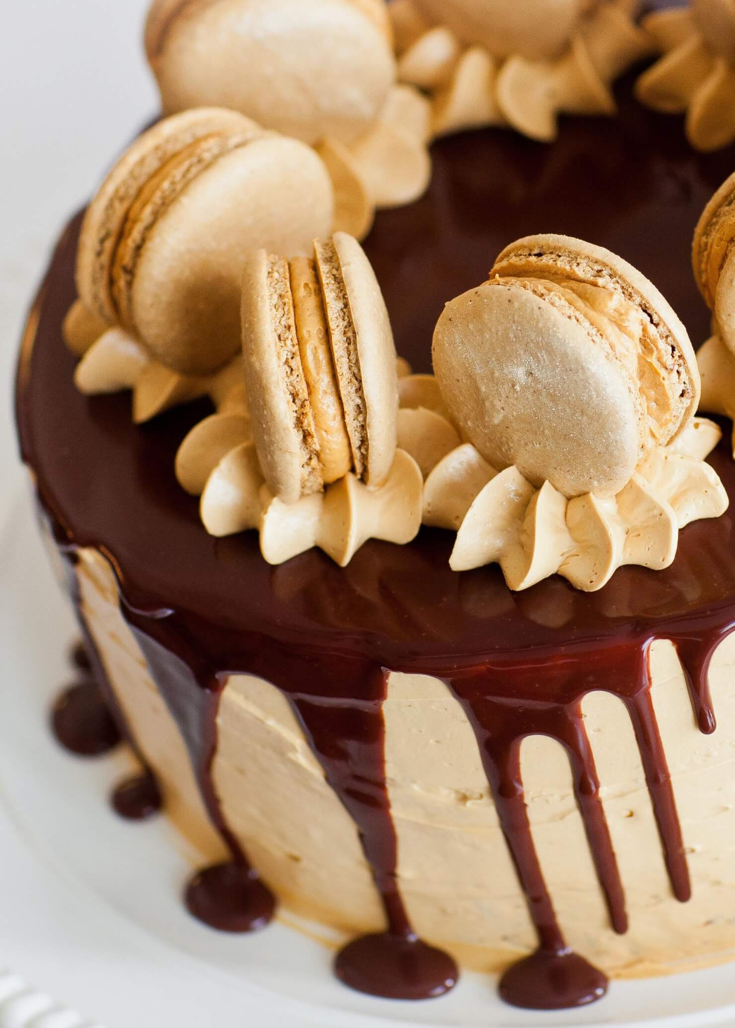 coffee caramel chocolate cake with macarons