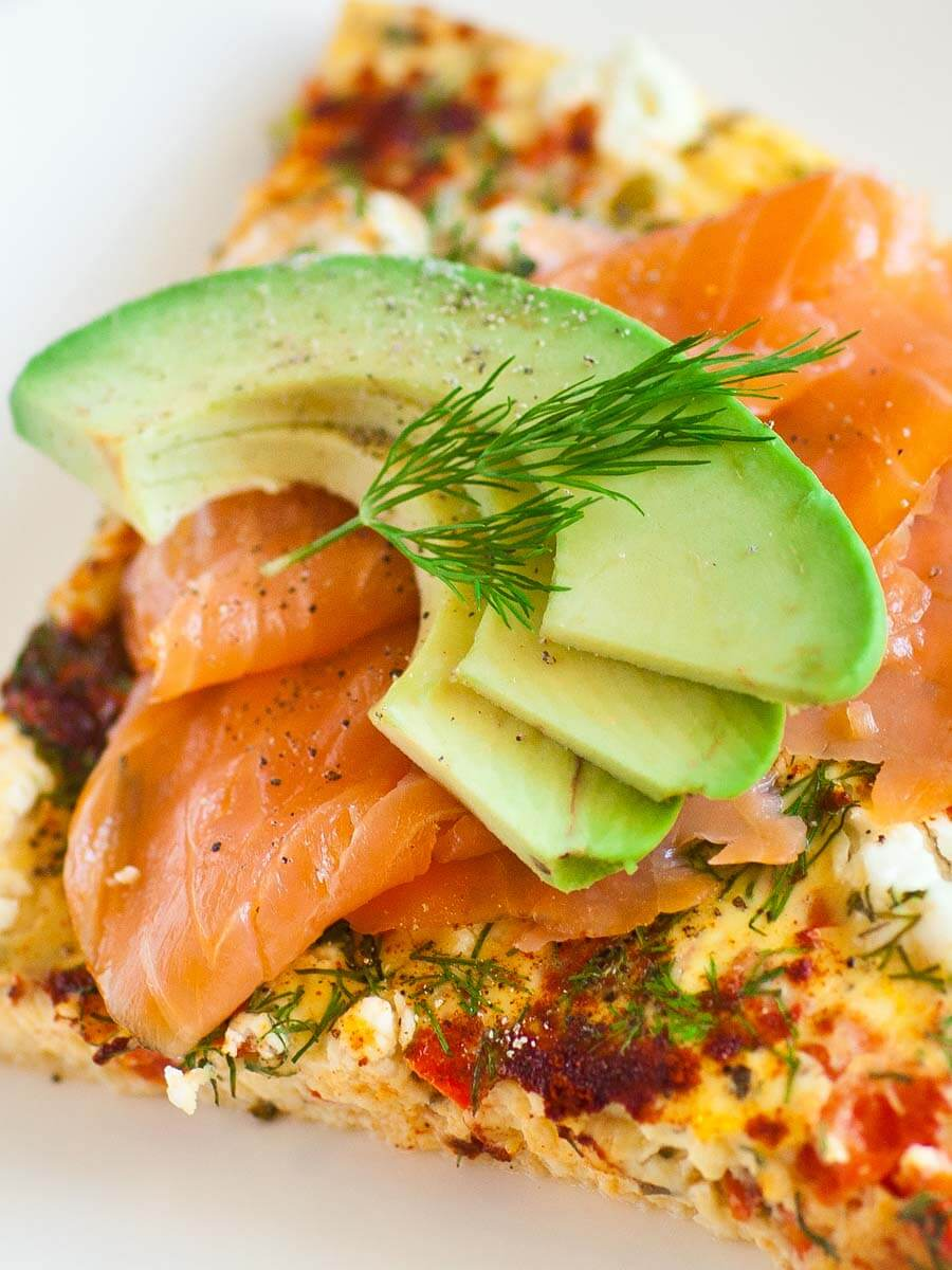 cheese and pepper frittata with smoked salmon, avocado, dill and goat cheese