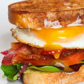 blt breakfast sandwich with runny egg yolk