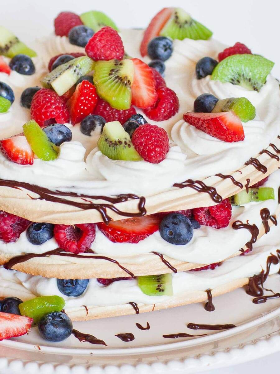 boccone dolce cake with whipped cream, meringue and berries