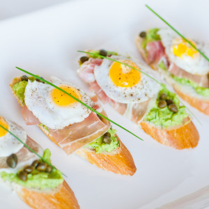 Quail Egg with Prosciutto and Avocado Spread on Toast
