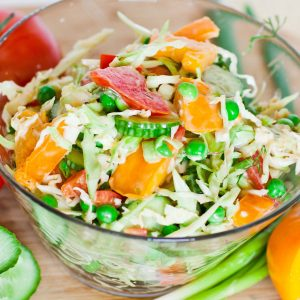 coleslaw salad with tomatoes and cucumber