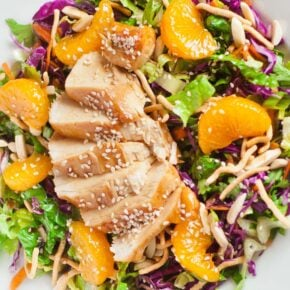 asian chicken salad with sesame chicken and mandarin wedges