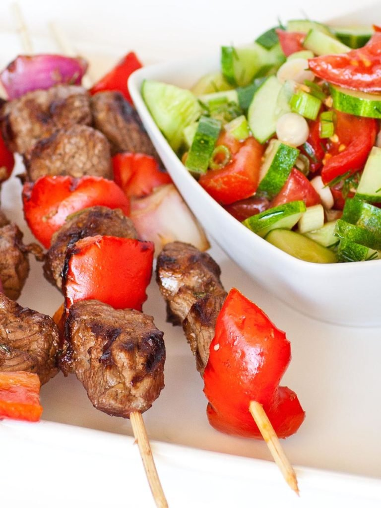 lamb kabobs with tomato cucumber salad