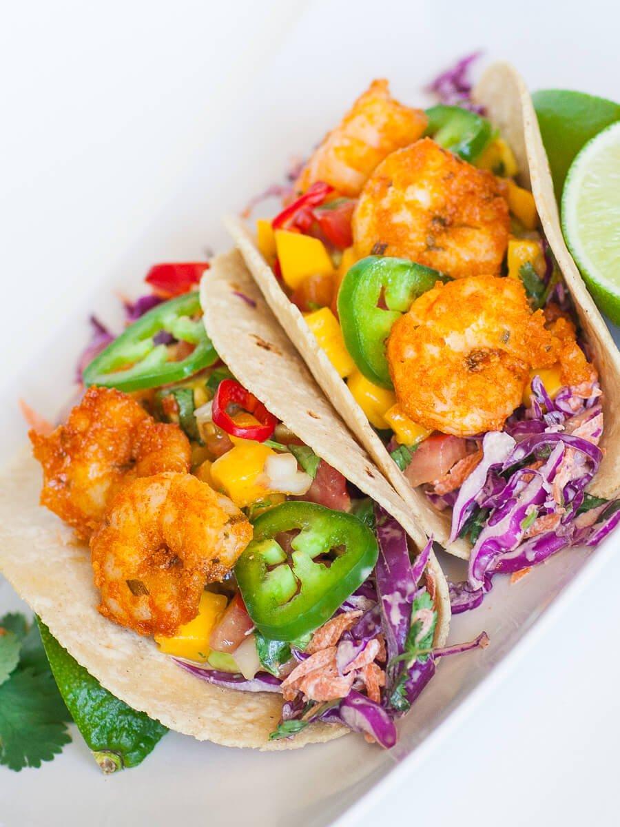 mango shrimp tacos with mango salsa and red cabbage slaw
