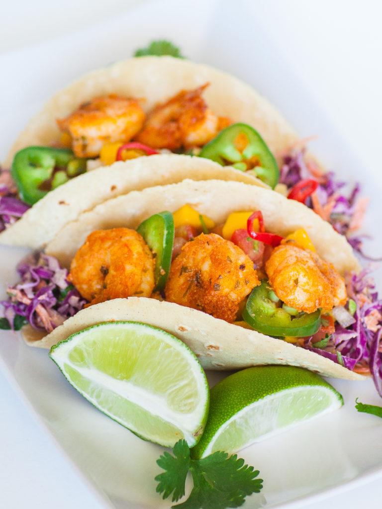 seafood tacos with limes, shrimp and avocado salsa
