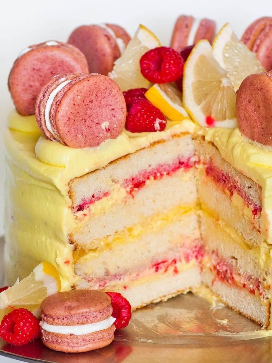 raspberry lemon cake with lemon buttercream and macarons