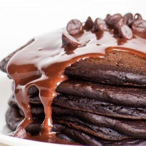 fluffy chocolate pancakes with chocolate sauce