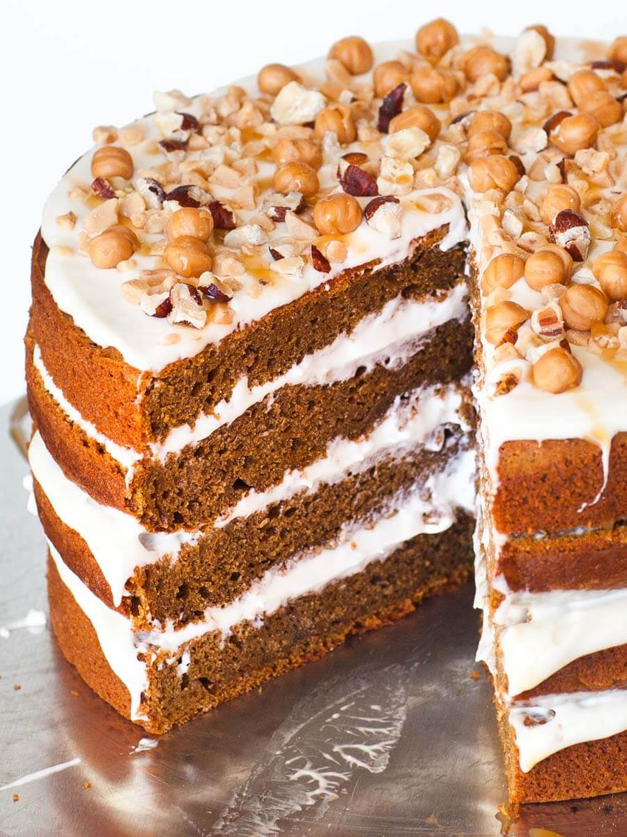 pumpkin spice cake with cream cheese frosting and caramel sauce