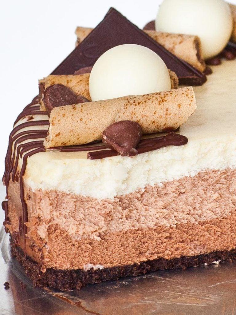 layered chocolate cheesecake with dark, milk and white chocolate