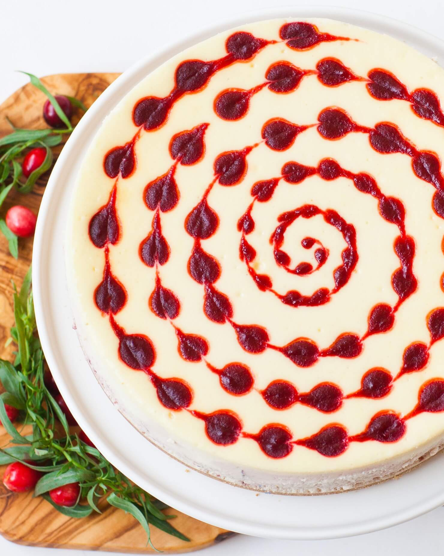 cranberry cheesecake with swirled cranberry sauce