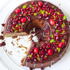 chocolate bundt cake with berries and nuts