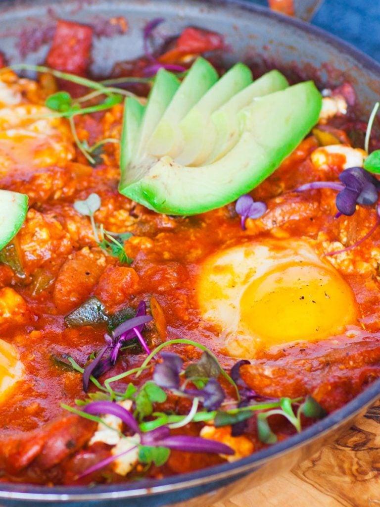 sausage and veggie shakshuka with eggs and avocado