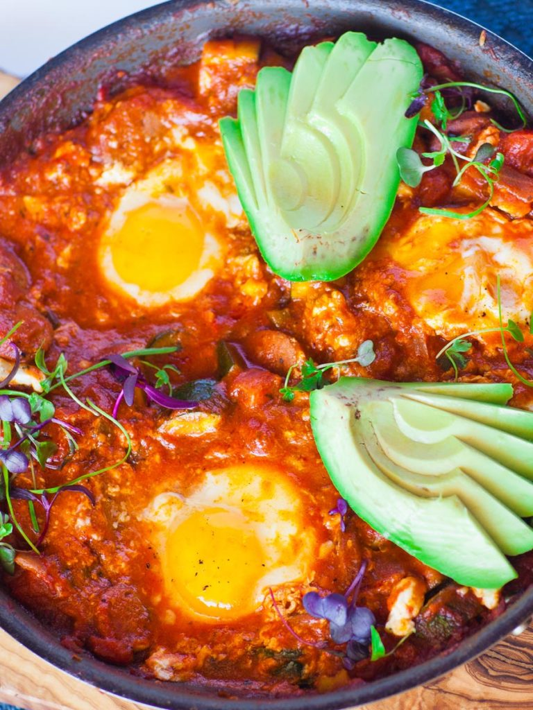 sausage shakshuka recipe with eggs and avocado