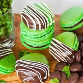 green chocolate mint macarons with chocolate on a table
