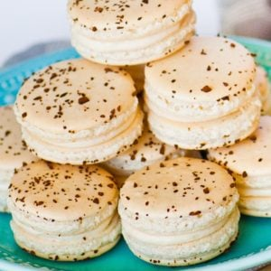 tiramisu flavored french macarons stacked on tray