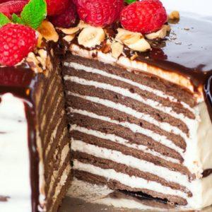8 layer chocolate spartak cake with raspberries