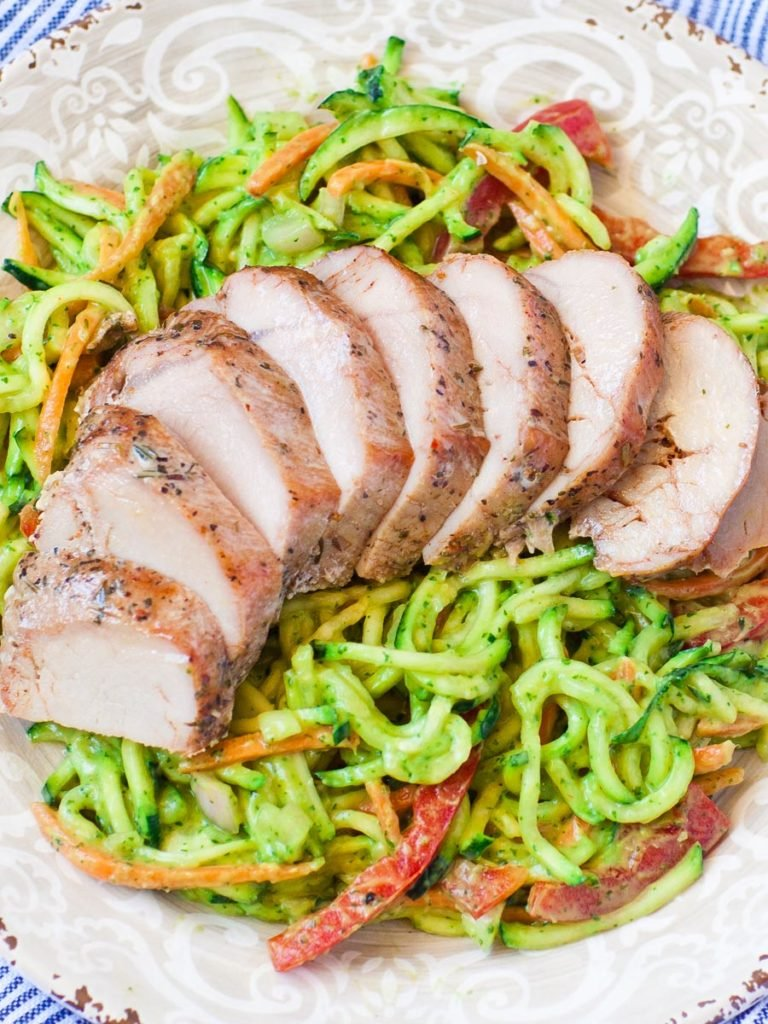 zoodle salad with avocado dressing and pork tenderloin
