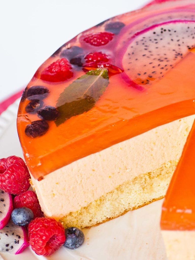 mango mousse cake with fruit and jello topping