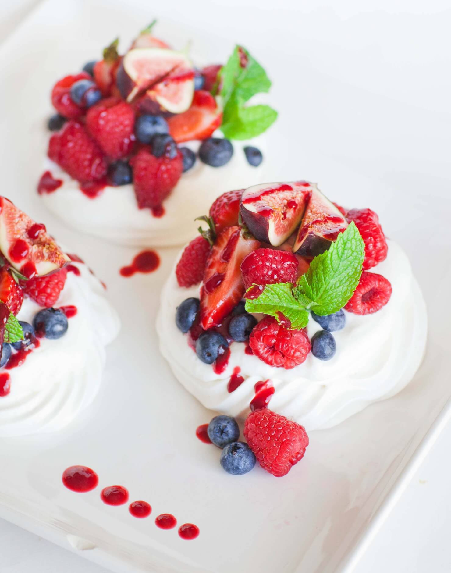 Mini Fruit Pavlova with Raspberry Coulis