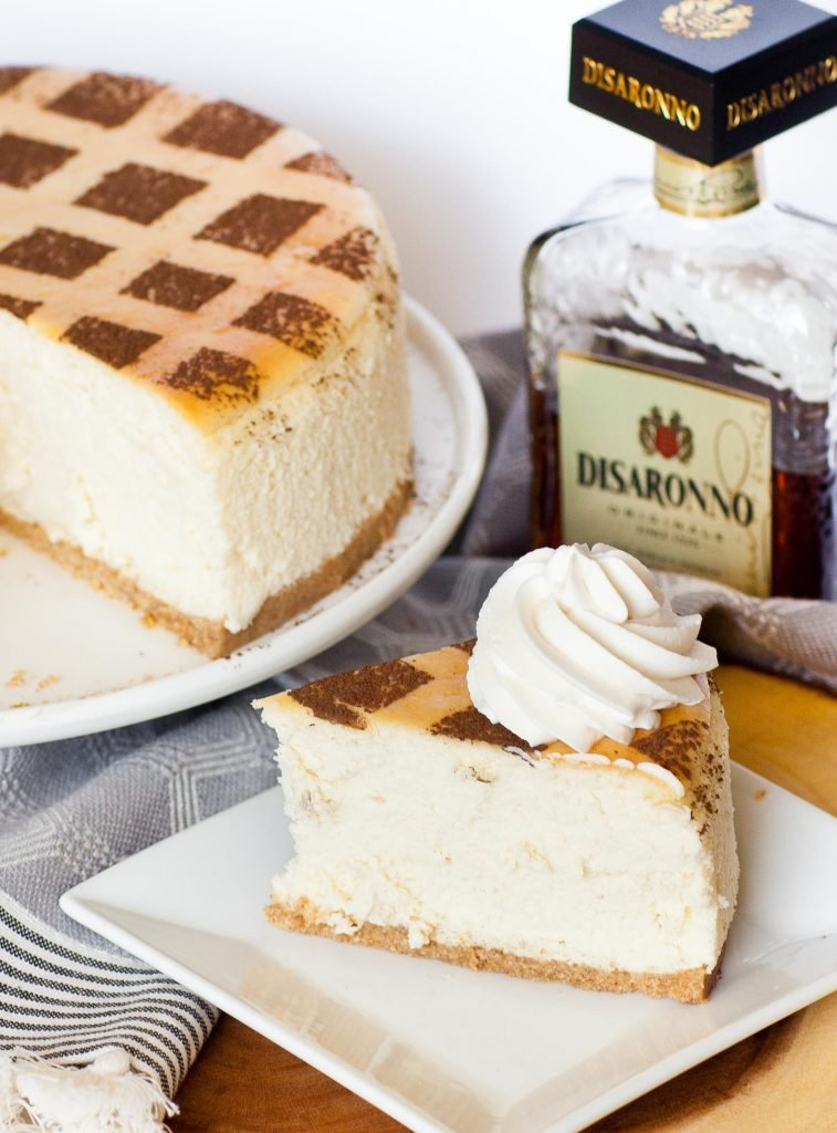 tiramisu cheesecake slice next to Disaronno almond liqueur