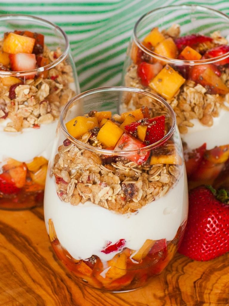 granola and peach yogurt parfaits with honey and chia seeds