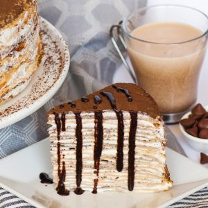 tiramisu crepe cake slice with chocolate