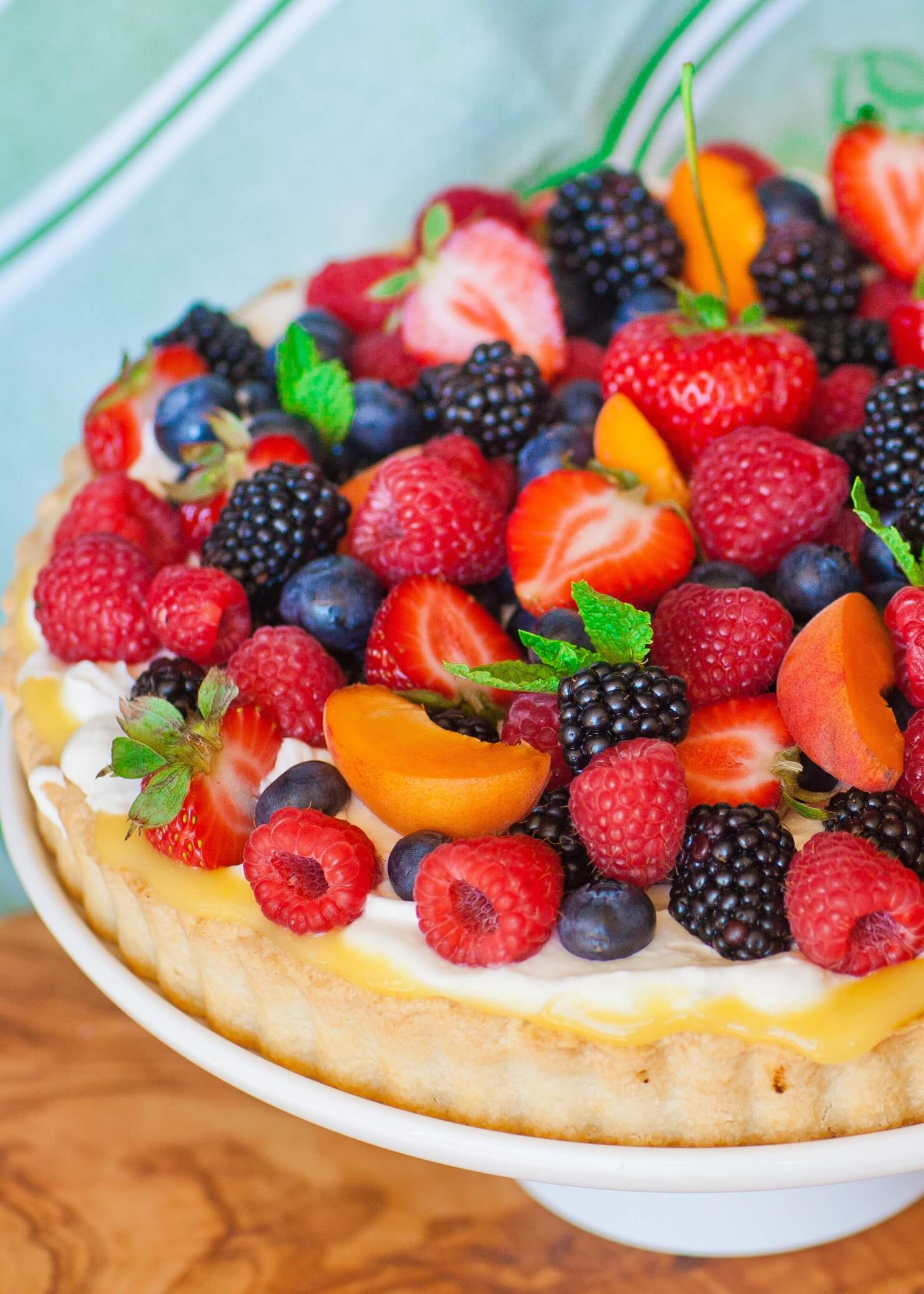 fruit tart with lemon curd and whipped cream